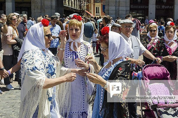 People in traditional costumes in Plaza Mayor during the celebration of San Isidro  Madrid city  Madrid  Spain.