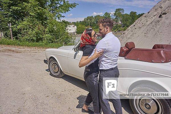 Couple at luxus oldtimer. Turkish ethnicity. High society. Bloggers Adem Bayalan and Emine Feruz Bayalan. Bavaria  Germany.