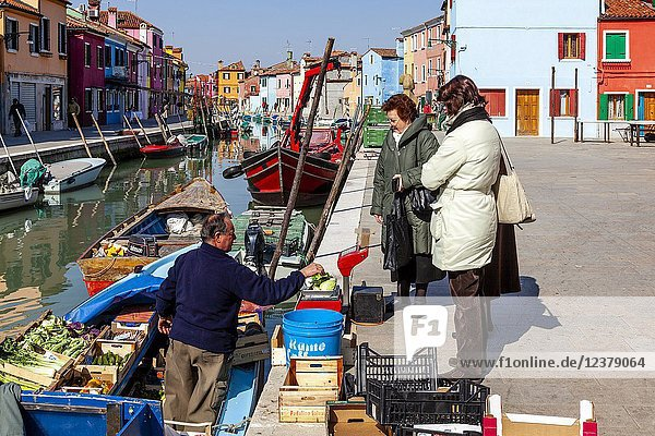Local Women Buy Fruit and Vegetables From A Mobile Shop  Burano Island  Venice  Italy.