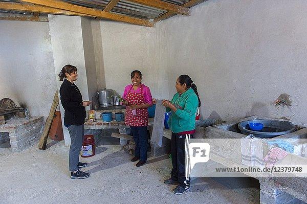 Women preparing breakfast in the community kitchen of the Mixtec village of San Juan Contreras near Oaxaca  Mexico.
