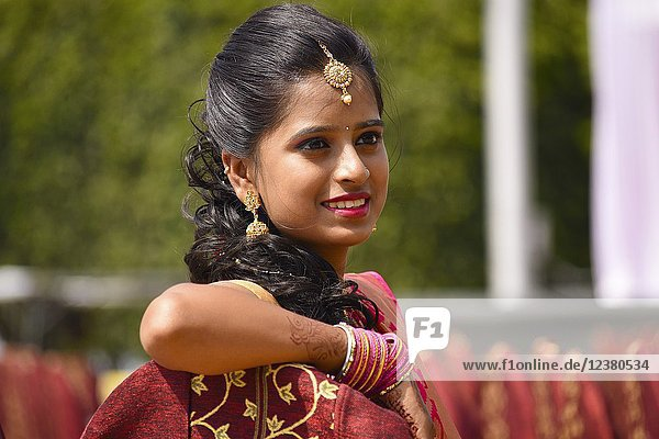 Close up of woman dressed in Indian attire and jewelry  Pune.