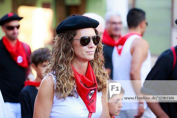 AMPUERO  SPAIN - SEPTEMBER 10: Unidentified woman just before the bull run on the street  encierro  during festival in Ampuero  celebrated on September 10  2016 in Ampuero  Spain