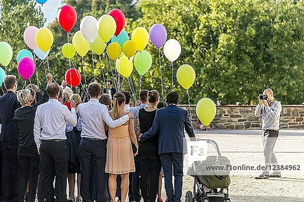 Photographer takes photos of a festive gathering with colourful balloons  Bad Homburg vor der Höhe  Hesse  Germany  Europe
