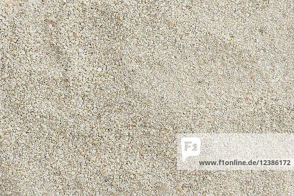 Dolomitkalk  Dolomitenkalk  Gartenkalk  natürliches Bodenverbesserungsmineral für Gartenbau  Studioaufnahme  Hintergrundbild