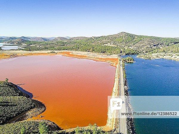 Street trough orange and blue lakes in mining region  Minas de Riotinto  Andalusia  Spain  Europe