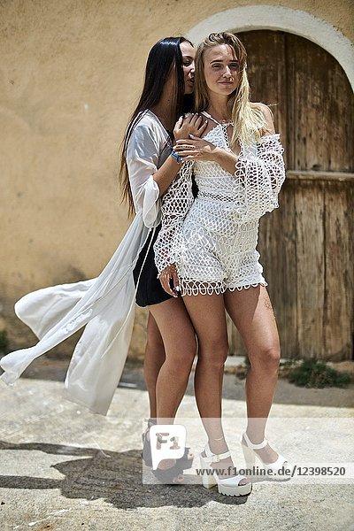 Two young women in holiday destination. Malia  Crete  Greece.