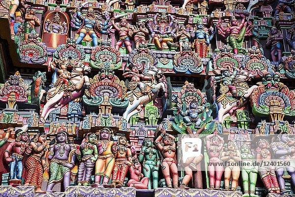 Colorful idols on the Gopuram  Sarangapani Temple  Kumbakonam  Tamil Nadu  India.