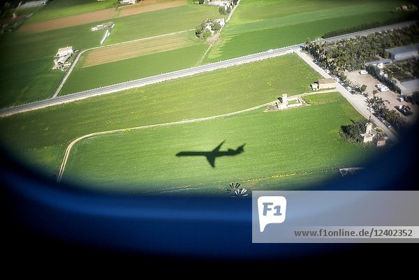 View of the shadow of aircraft from the window of a plane. Palma de Mallorca  Spain  Europe.