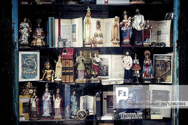 Shop window of a shop of objects  books and religious images. Lisbon  Portugal.