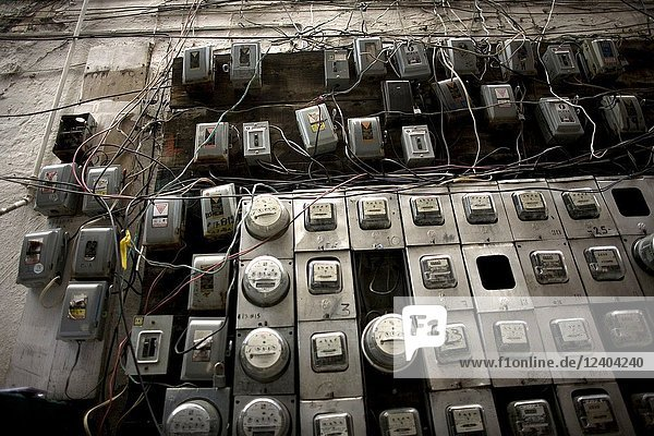 Electricity meters hang on a wall in an apartment buiding in Mexico City  October 23  2009. The Mexican government shut down the state-run power company Luz y Fuerza del Centro (LFC) on October 11.