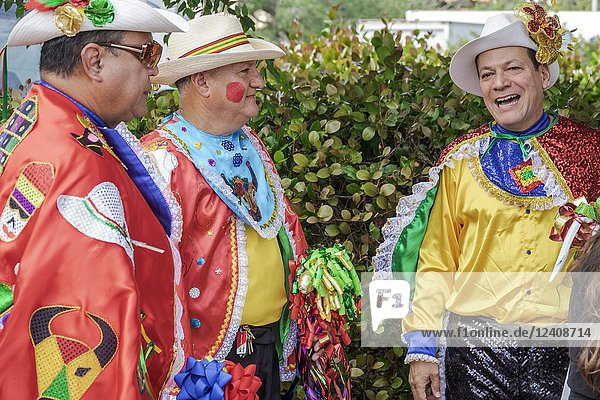 Florida  Coral Gables  Hispanic Cultural Festival  Latin American event  dance group  dancer performer  Colombian typical costume  Baile del Garabato  Barranquilla Carnival folklore  Hispanic  man  talking