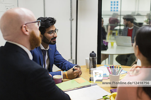 Creative business people talking in conference room meeting