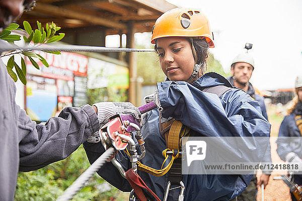 Woman preparing zip line equipment