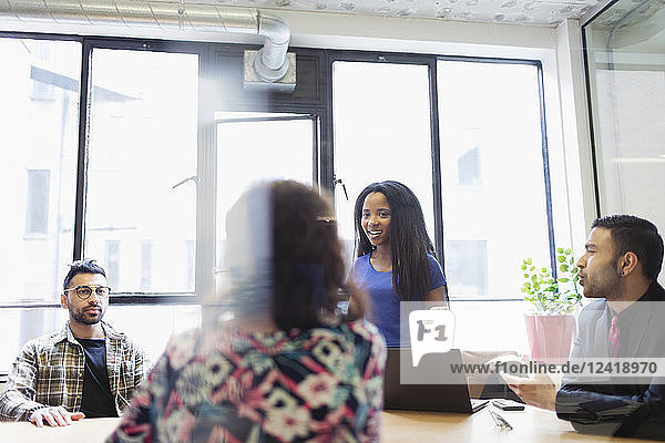 Creative businesswoman leading conference room meeting