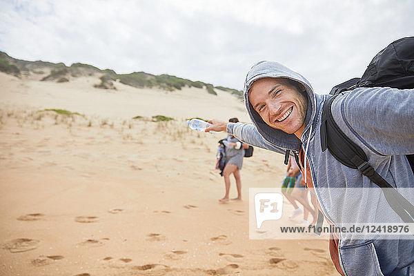 Portrait happy  carefree man on beach