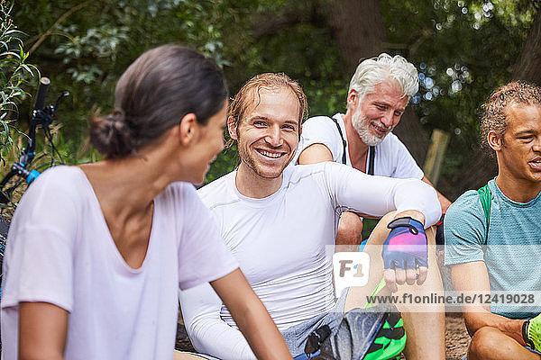 Happy friends mountain biking  resting
