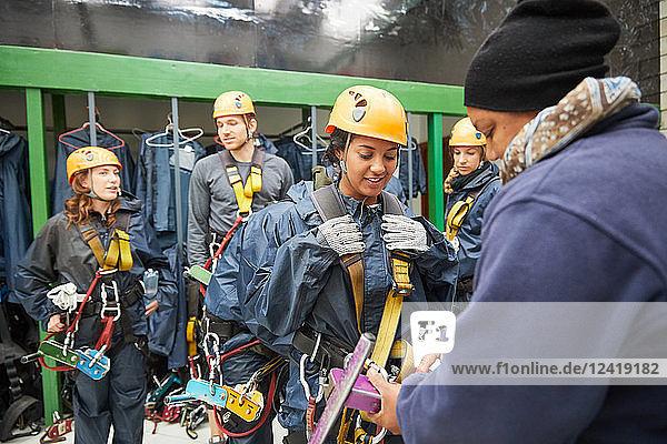 Friends preparing zip line equipment