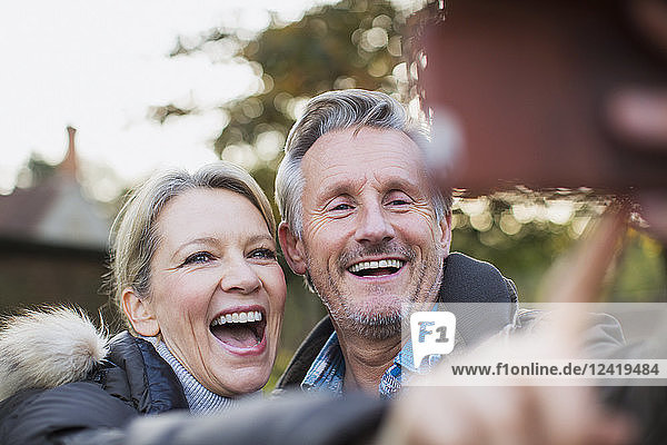 Happy  playful mature couple taking selfie