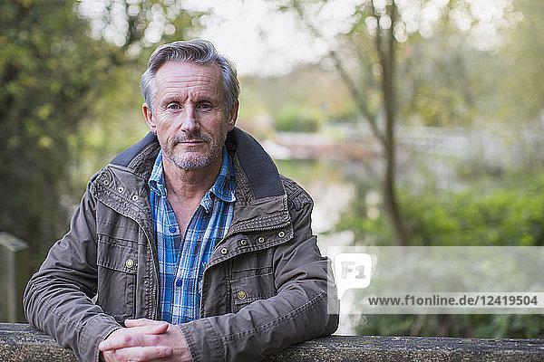 Portrait confident senior man in park