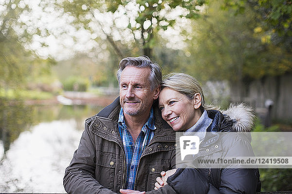 Affectionate mature couple in autumn park