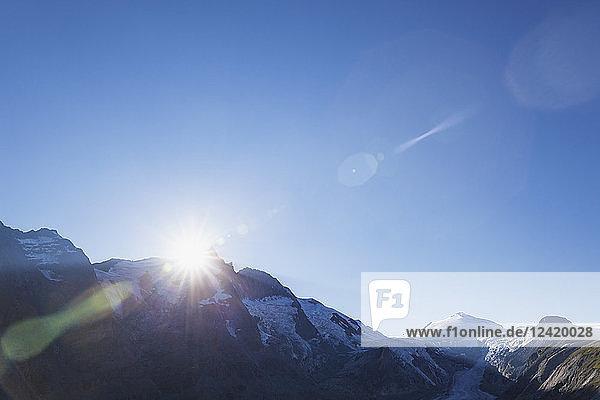 Austria  Carinthia  sundown  last sunbeams of the day at Grossglockner peak  on right Pasterze glacier and Johannisberg  High Tauern National Park