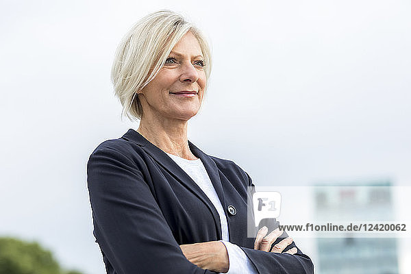 Portrait of confident senior businesswoman outdoors