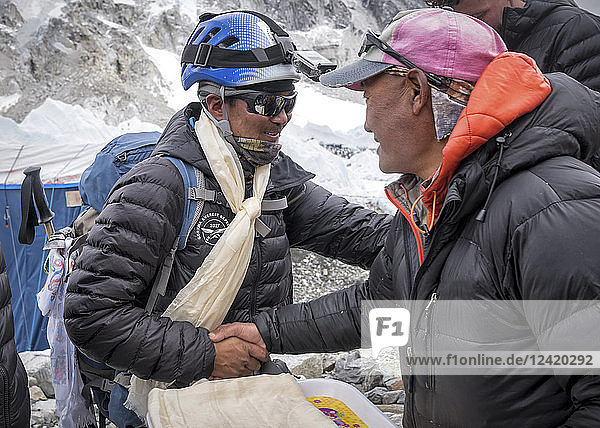Nepal  Solo Khumbu  Everest  Sagamartha National Park  People greeting at the base camp