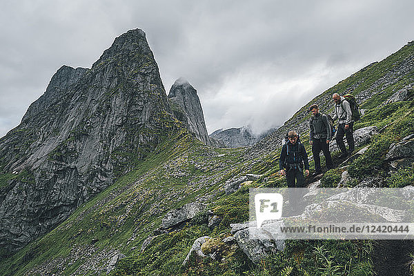 Norway  Lofoten  Moskenesoy  Young men hiking at Markan mountain