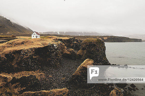 Iceland  North of Iceland  landscape with single white house
