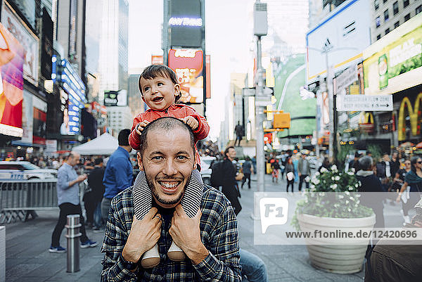 USA  New York  New York City  Times Square  Father with baby on shoulders