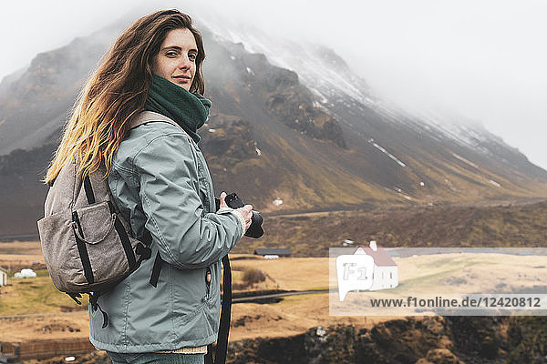 Iceland  portrait of hiker with backpack and camera