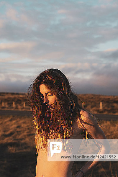 Iceland  naked young woman at sunset