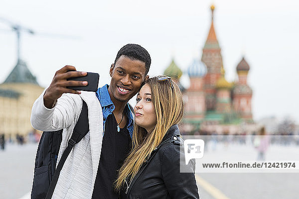Russia  Moscow  couple taking a selfie and smiling