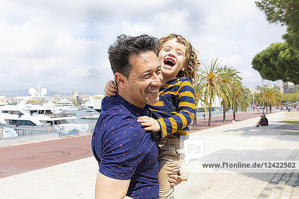 Spain  Barcelona  father and son playing together and having fun