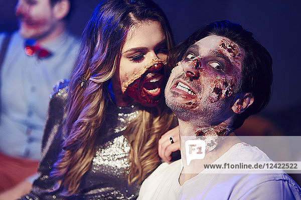 Creepy woman trying to bite her boyfriend at Halloween party Creepy woman trying to bite her boyfriend at Halloween party