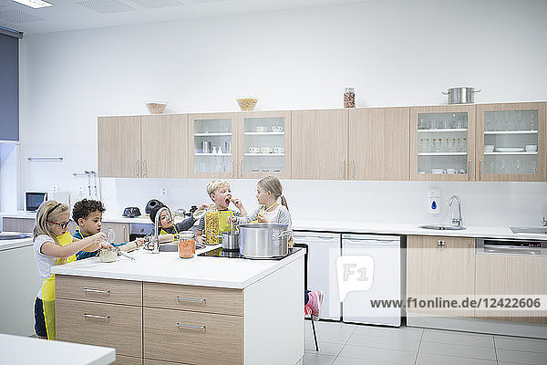 Pupils cooking together in cooking class