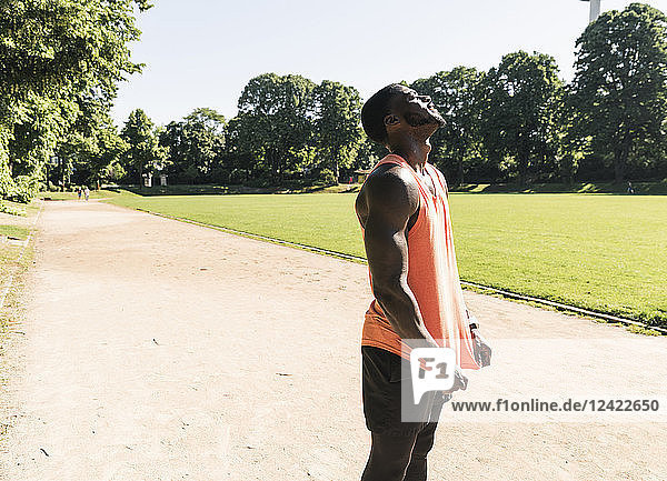 Young athlete exercising on sports field  looking up