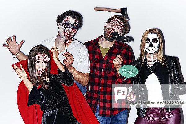 Friends in creepy Halloween costumes  portrait Friends in creepy Halloween costumes, portrait