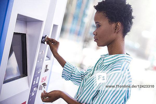 Woman at ticket machine Woman at ticket machine