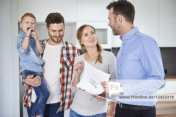 Family and real estate agent talking in new apartment Family and real estate agent talking in new apartment
