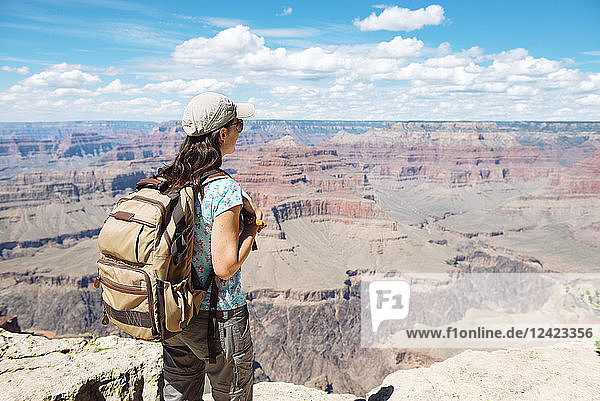 USA  Arizona  Grand Canyon National Park  Young woman with backpack exploring and enjoying the landscape