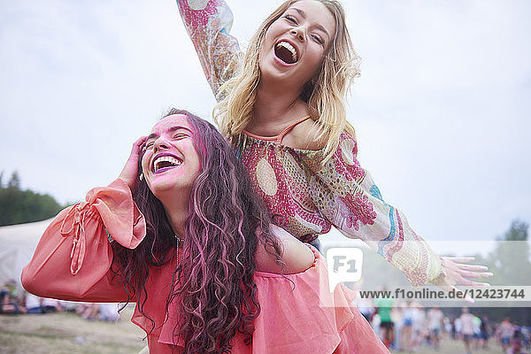 Playful friends having fun at the music festival Playful friends having fun at the music festival