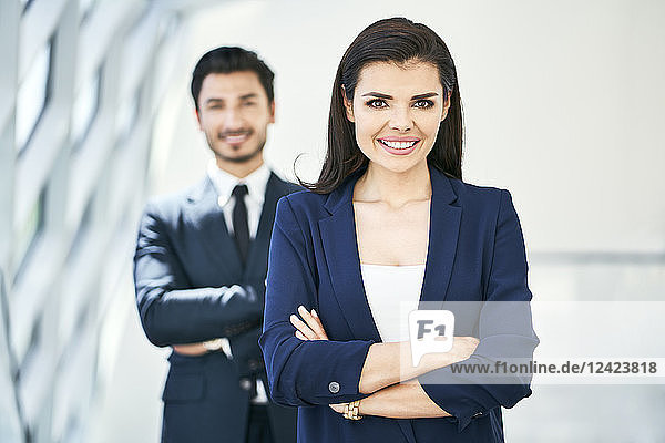 Portrait of smiling businesswoman and businessman