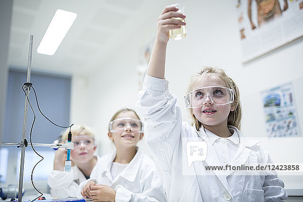 Pupils in science class experimenting with liquid