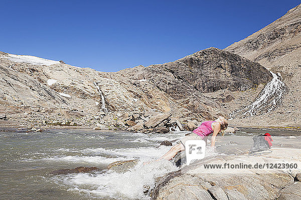Austria  Carinthia  Grossglockner  Pasterze  woman enjoying refreshing break from hiking  High Tauern National Park
