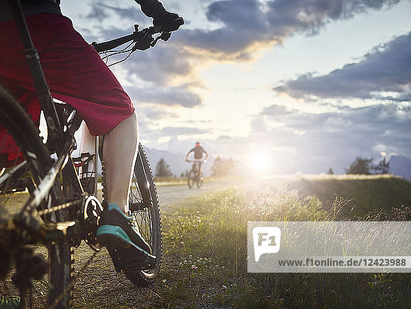 Austria  Tyrol  male and female downhill mountain biker