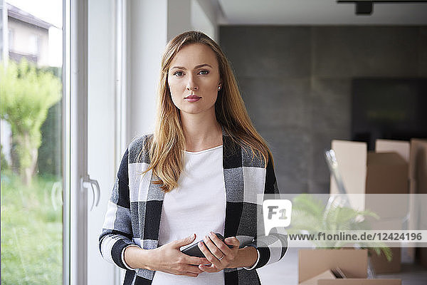 Portrait of serious woman moving into new flat Portrait of serious woman moving into new flat