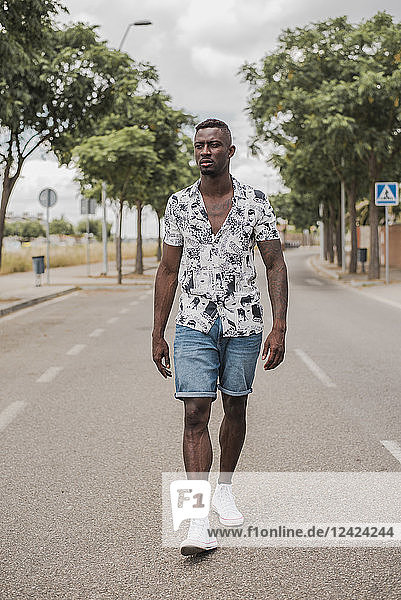 Young man walking in the street