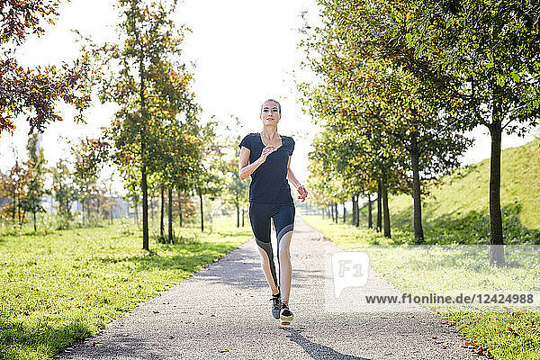 Young woman running in a park