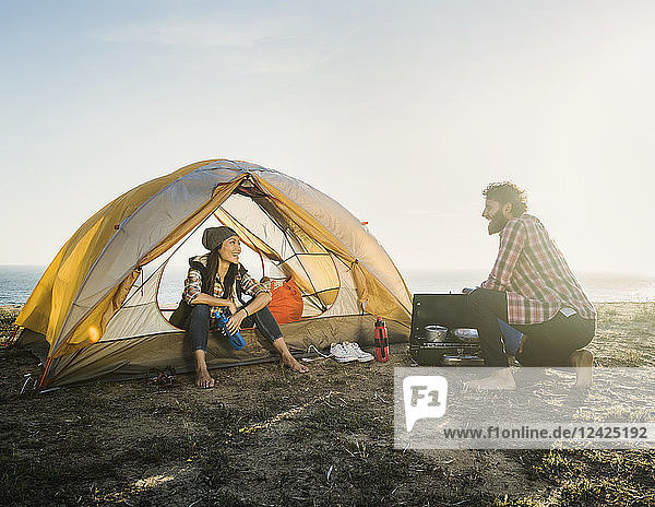 Couple camping on beach